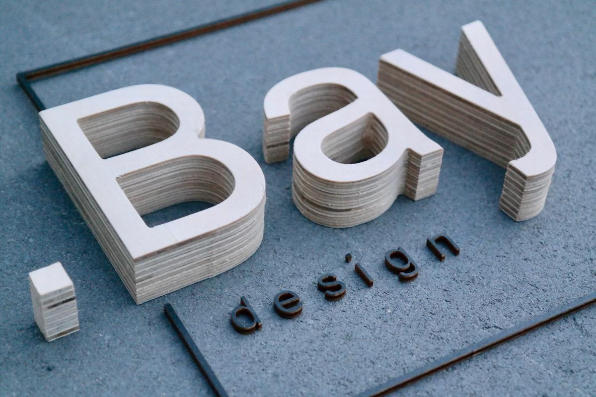Logo gefräst und Gelasert aus Holz